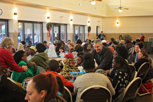 Executive-Director-Travis-McNeal-serves-food-at-our-Christmas-season-toy-giveaway-event-last-year